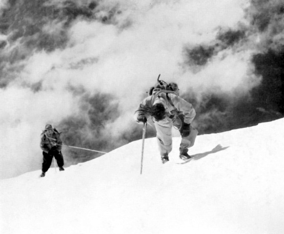 Two climbers head for the summit with the Chamonix valley in the background