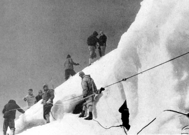 Historical image of a group climbing roped together